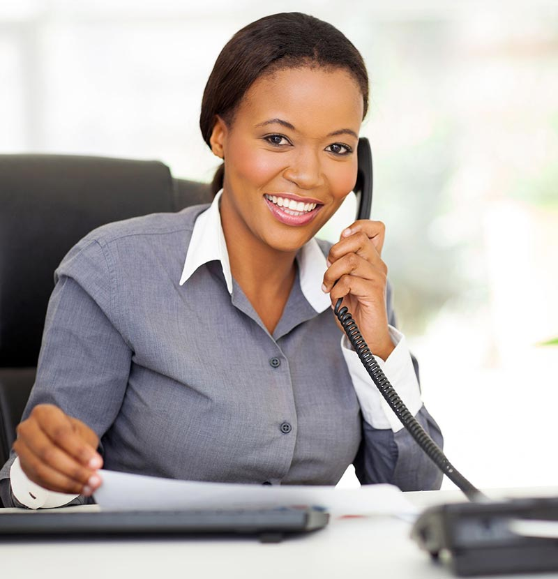 Women on phone at desk